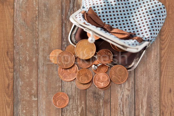 close up of euro coins and wallet on table Stock photo © dolgachov