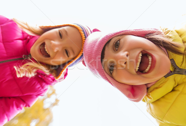 happy laughing girls faces outdoors Stock photo © dolgachov