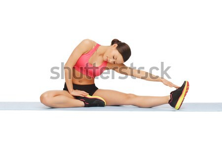 Stock photo: sporty woman doing exercise on the floor