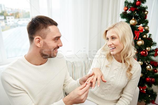 Człowiek pierścionek zaręczynowy kobieta christmas miłości para Zdjęcia stock © dolgachov