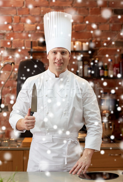 happy male chef cook in kitchen with knife Stock photo © dolgachov
