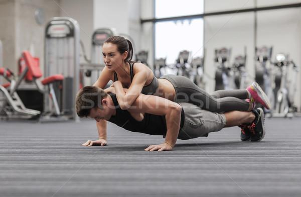 笑みを浮かべて カップル ジム フィットネス スポーツ ストックフォト © dolgachov