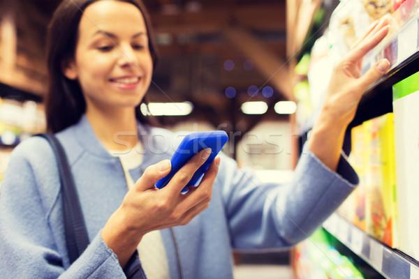 Foto d'archivio: Felice · smartphone · mercato · vendita · shopping