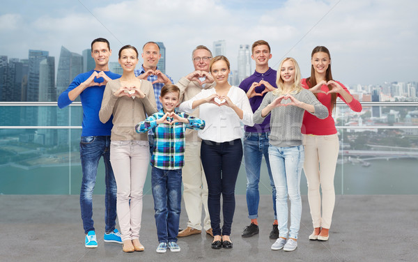 people showing heart hand sign over city waterside Stock photo © dolgachov