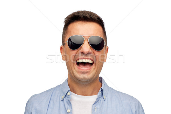 face of smiling man in shirt and sunglasses Stock photo © dolgachov