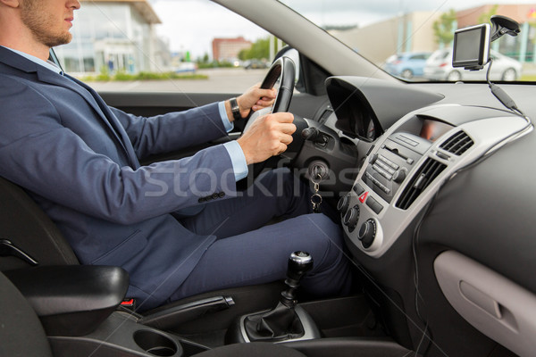 close up of young man in suit driving car Stock photo © dolgachov
