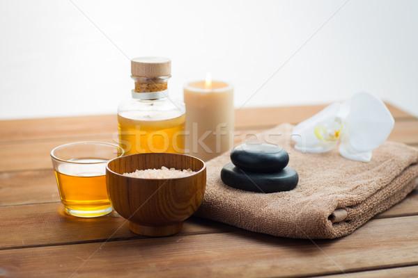 close up of salt, massage oil and bath stuff Stock photo © dolgachov
