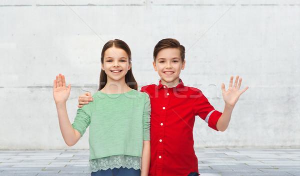 happy boy and girl waving hand Stock photo © dolgachov