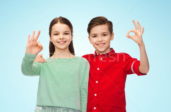 Fille signe de la main enfance Photo stock © dolgachov