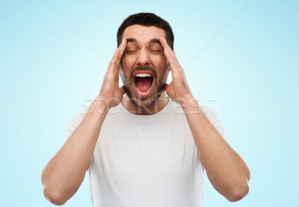 őrült kiált férfi póló kék érzelmek Stock fotó © dolgachov