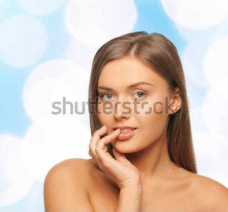 woman with bare shoulders touching face Stock photo © dolgachov
