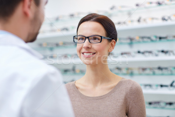 woman in glasses with optician at optics store Stock photo © dolgachov