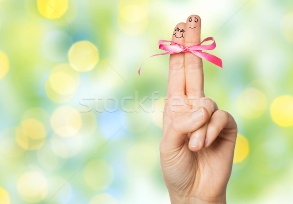 close up of two fingers tied by pink bow knot Stock photo © dolgachov