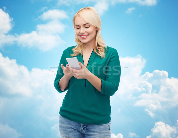 happy woman with smartphone texting message Stock photo © dolgachov
