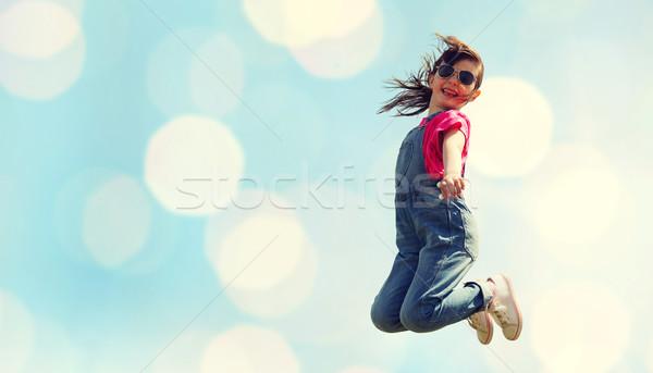 Stockfoto: Gelukkig · meisje · springen · hoog · Blauw · lichten