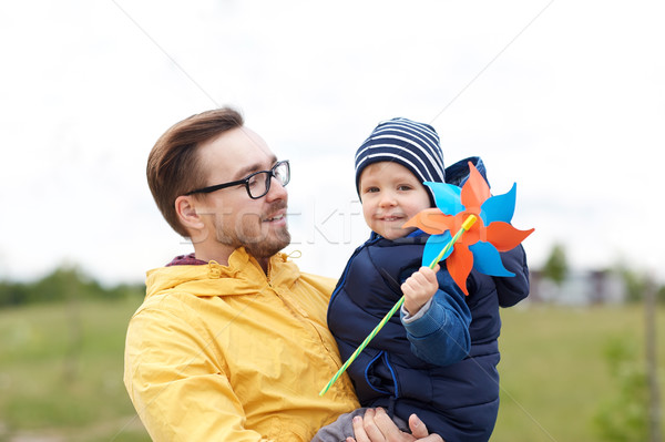 happy father and son with pinwheel toy outdoors Stock photo © dolgachov