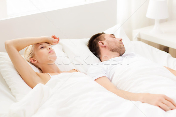 couple sleeping in bed at home Stock photo © dolgachov