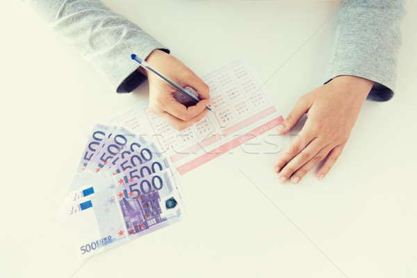 close up of hands with lottery ticket and money Stock photo © dolgachov