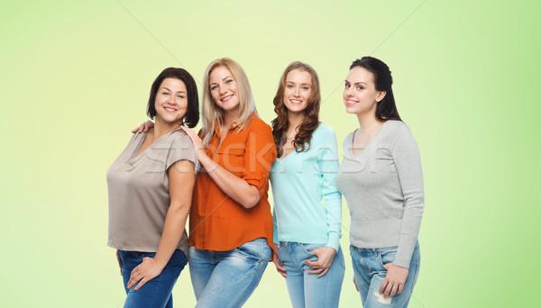 Grupy szczęśliwy inny kobiet przypadkowy ubrania Zdjęcia stock © dolgachov