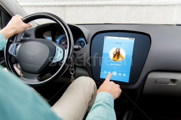 man driving car with music on board computer Stock photo © dolgachov