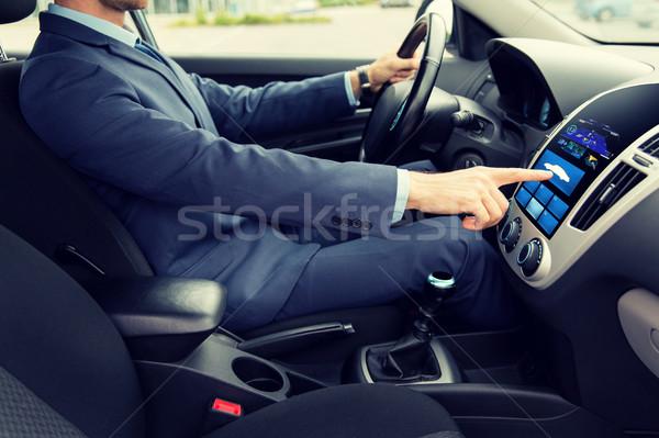 close up of man driving car with board computer Stock photo © dolgachov