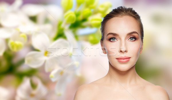 beautiful young woman face over white background Stock photo © dolgachov