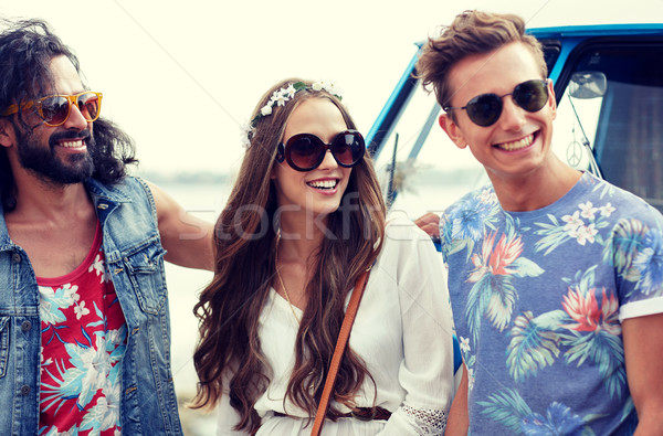 smiling young hippie friends over minivan car Stock photo © dolgachov