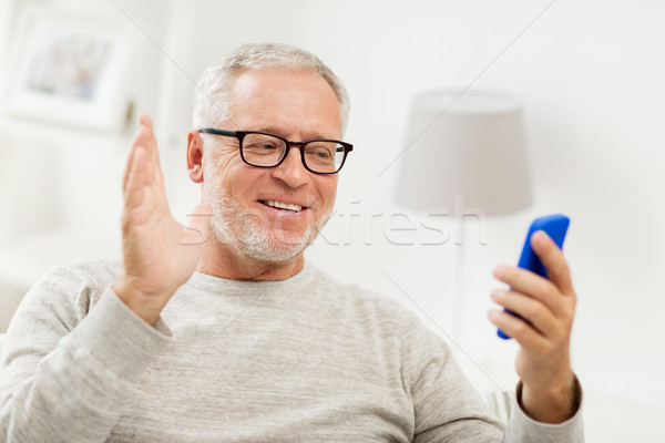 senior man having video call on smartphone at home Stock photo © dolgachov