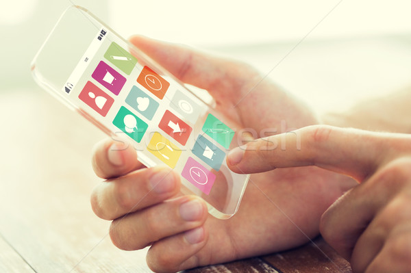 close up of hand with menu icons on smartphone Stock photo © dolgachov