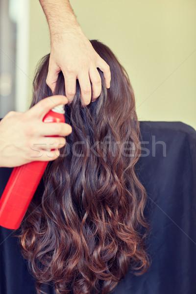 stylist with hair spray making hairdo at salon Stock photo © dolgachov