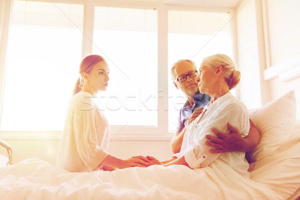 family visiting ill senior woman at hospital Stock photo © dolgachov