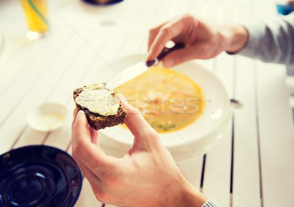 рук масло хлеб ресторан Сток-фото © dolgachov