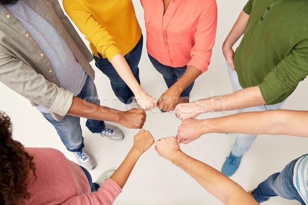 Handen internationale mensen vuist buil Stockfoto © dolgachov