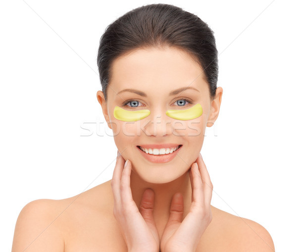 beautiful young woman face with under-eye patches Stock photo © dolgachov