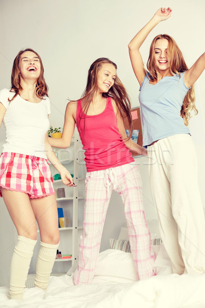 Stock photo: happy friends or teen girls having fun at home