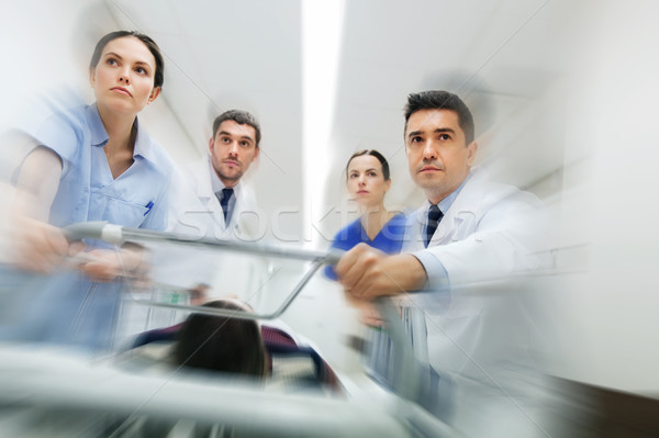 medics and patient on hospital gurney at emergency Stock photo © dolgachov