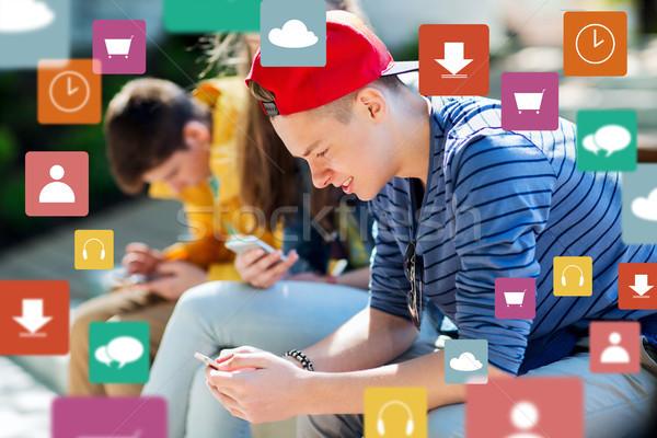 happy teenage friends with smartphones outdoors Stock photo © dolgachov