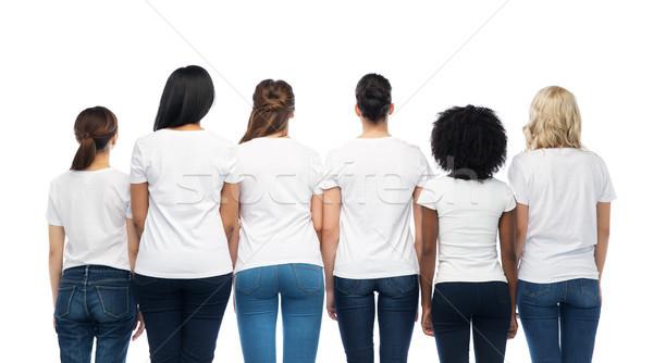 international group of women from back Stock photo © dolgachov