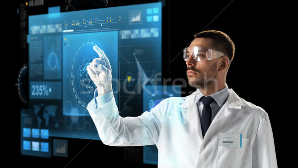 doctor or scientist in goggles with virtual screen Stock photo © dolgachov