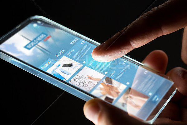 hands with business web page on smartphone screen Stock photo © dolgachov