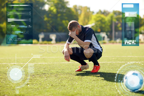 sad soccer player with ball on football field Stock photo © dolgachov
