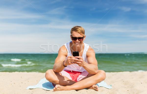 Feliz sonriendo joven playa verano Foto stock © dolgachov