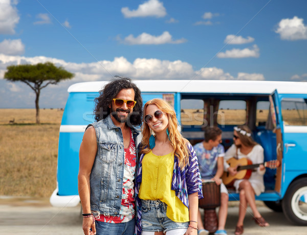 happy hippie couples and minivan in africa Stock photo © dolgachov