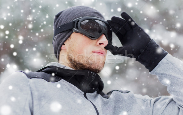 close up of sports man with ski goggles in winter Stock photo © dolgachov