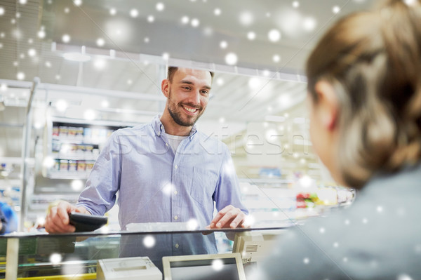 happy man with wallet at store cash register Stock photo © dolgachov