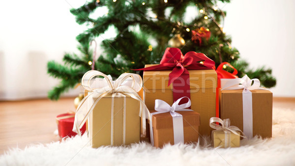 gift boxes on sheepskin at christmas tree Stock photo © dolgachov