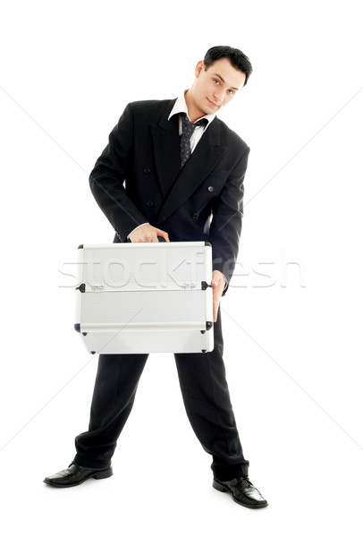 businessman with metal container Stock photo © dolgachov