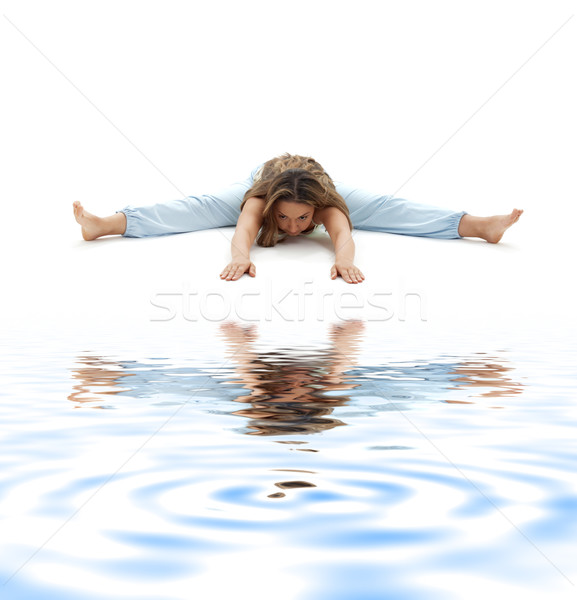 upavistha konasana wide-angle seated forward bend on white sand Stock photo © dolgachov