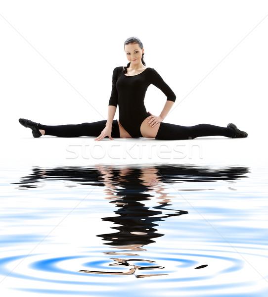 fitness instructor in black leotard on white sand Stock photo © dolgachov