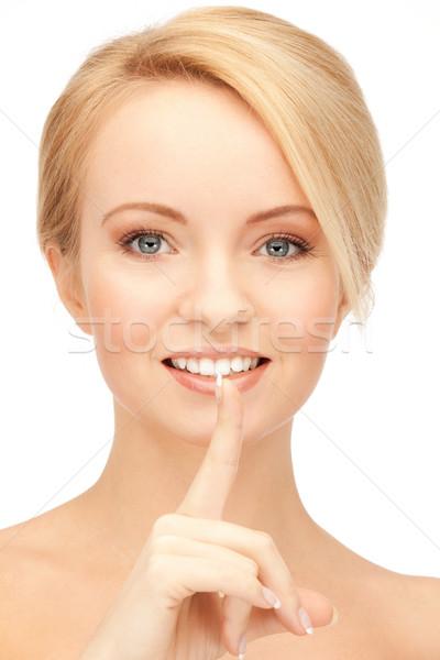 Nő ujj ajkak fényes kép fiatal nő Stock fotó © dolgachov